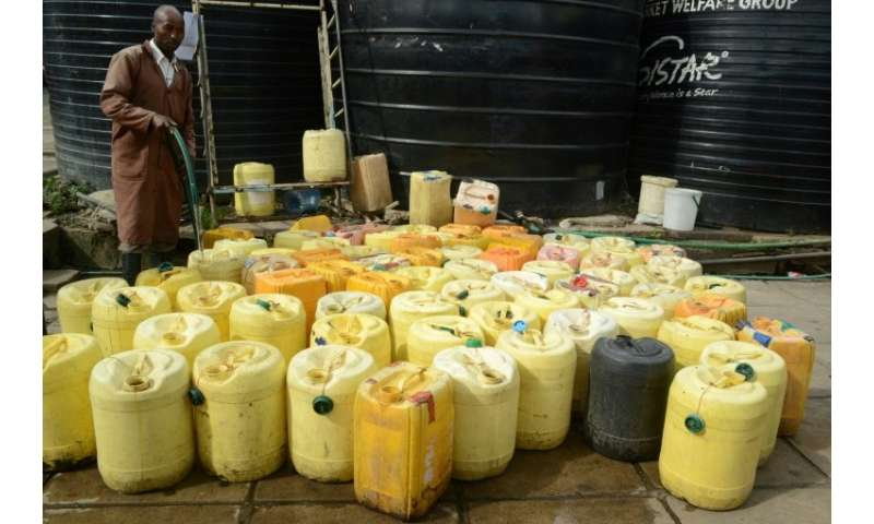 Waterboys supply water to butchers, fishmongers and restaurants in the crowded Kenyatta market