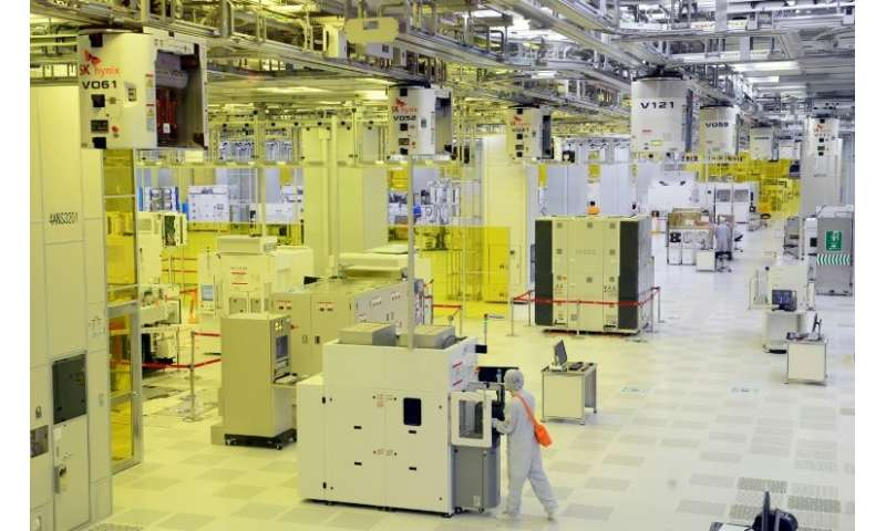 Workers on the operations floor of a plant in Icheon run by SK Hynix, which saw quarterly net profit leap 98 percent year-on-yea