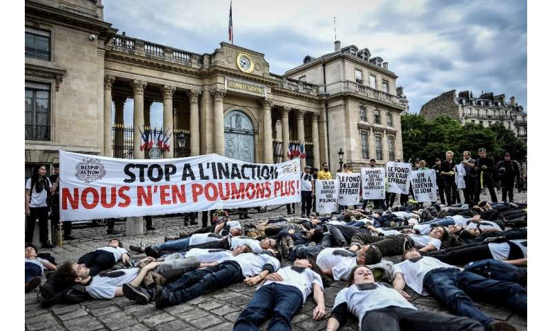 """Activists stage a """"die-in"""" on June 4, 2019 to denounce the air quality outside the French National Assembly in Paris"""