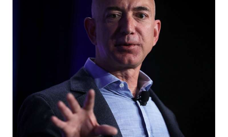 Amazon, whose CEO Jeff Bezos is seen here, posted record profits as it diversified into new areas such as digital advertising an