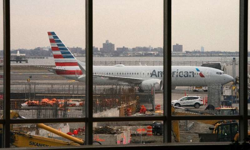 An American Airlines 737 Max sits at the gate at LaGuardia airport on March 13, 2019 in New York