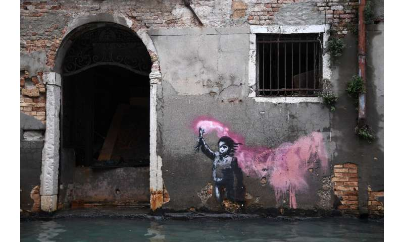 An artwork by Banksy portraying a migrant child wearing a lifejacket and holding a neon pink flare remained just above water