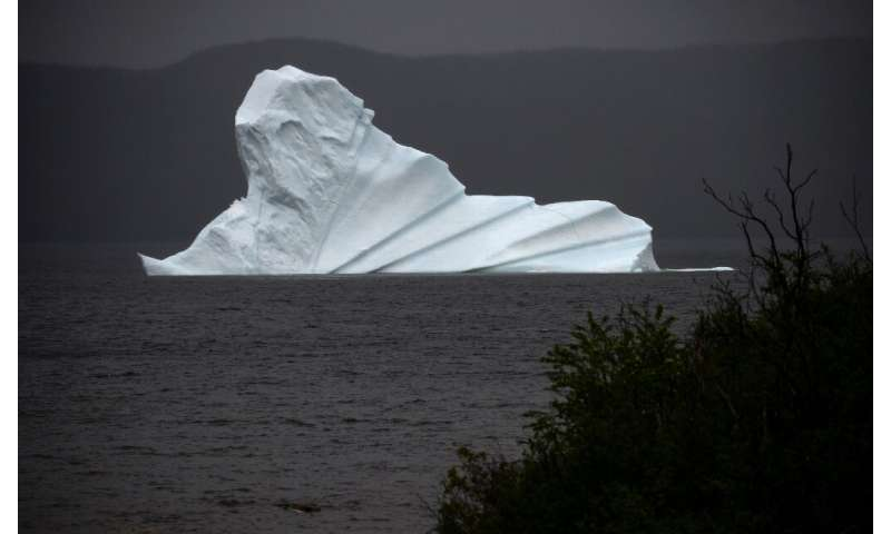"""An iceberg floats near King's Point, which is located on Canada's newly christened """"Iceberg Corridor"""""""