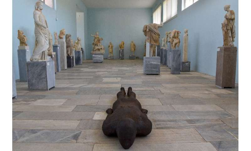 Antony Gormley's steel sculpture 'Shift II' lies among sculptures from ancient Greece dating back more than 2,000 years