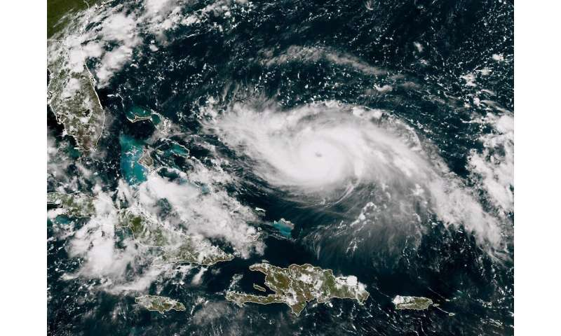 A satellite image shows Hurricane Dorian approaching the Bahamas and Florida on August 30