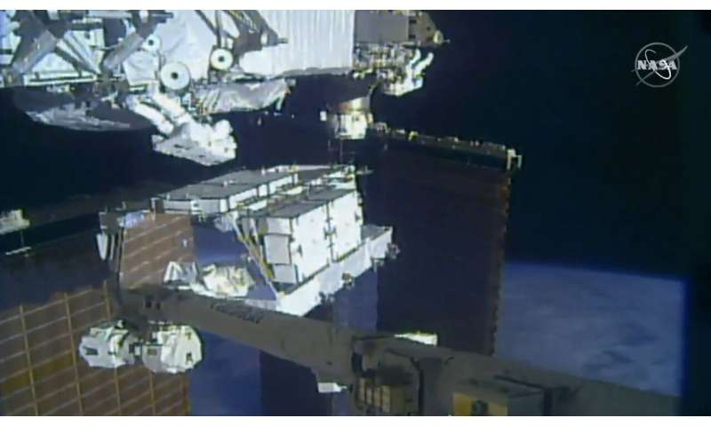 Astronauts replace old batteries in 1st of 5 spacewalks