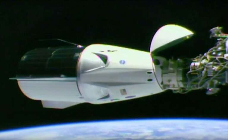 A video grab taken from a NASA/SpaceX webcast transmission on March 3, 2019 shows SpaceX Dragon capsule docked at the Internatio