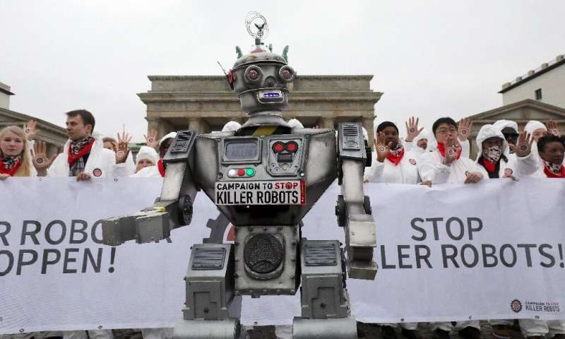 "Demonstrators in Berlin take part in a ""Stop Killer Robots"" campaign organized by German NGO ""Facing Finance&quot"