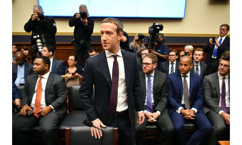 "Facebook Chairman and CEO Mark Zuckerberg arrives to testify before the House Financial Services Committee on ""An Examinati"