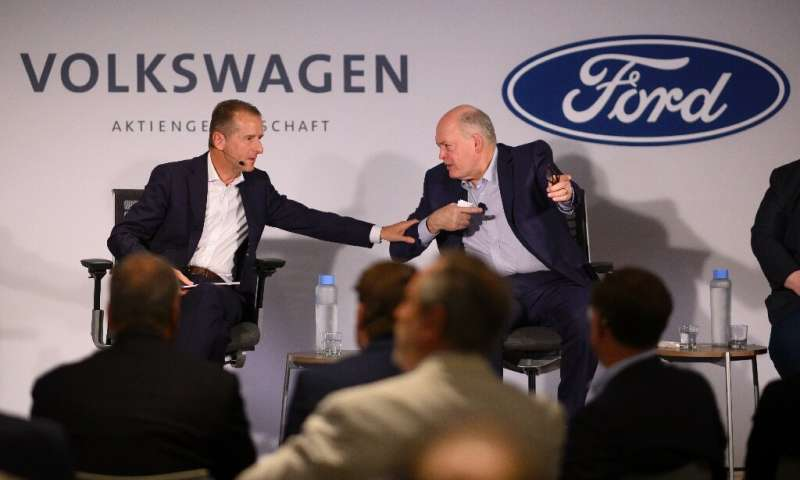Ford chief Jim Hackett (R), and VW CEO Herbert Diess are joining forces on the future of the auto industry