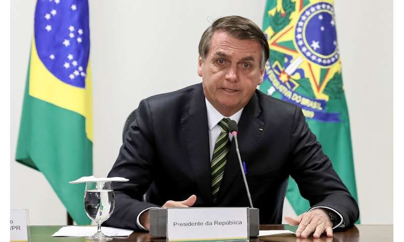 Handout picture released by the Brazilian Presidency showing Brazilian President Jair Bolsonaro during a meeting with governors