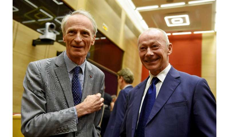 Happier days: Bollore (R) and Senard ahead of a French Senate hearing on September 24, 2019