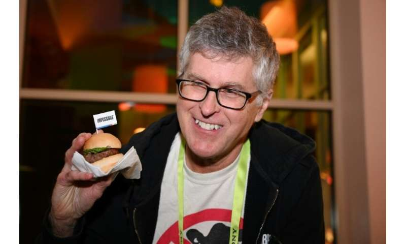 Impossible Foods CEO Pat Brown—holding up the Impossible Burger 2.0 at a press event in Las Vegas, Nevada on January 7, 2019—fou