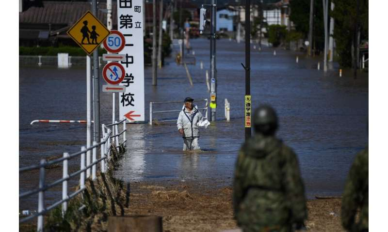 Japan's military has been deployed to rescue people trapped in areas hit by flooding after Typhoon Hagibis