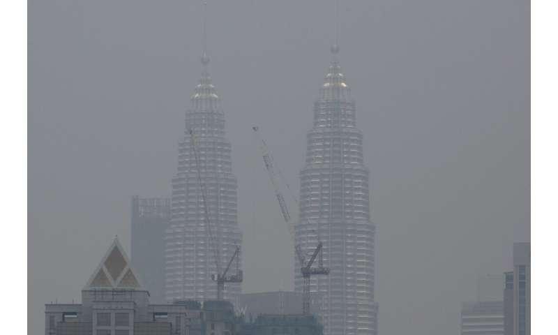 Malaysia's landmark Petronas Twin Towers are shrouded in haze in Kuala Lumpur as fires rage in Indonesia