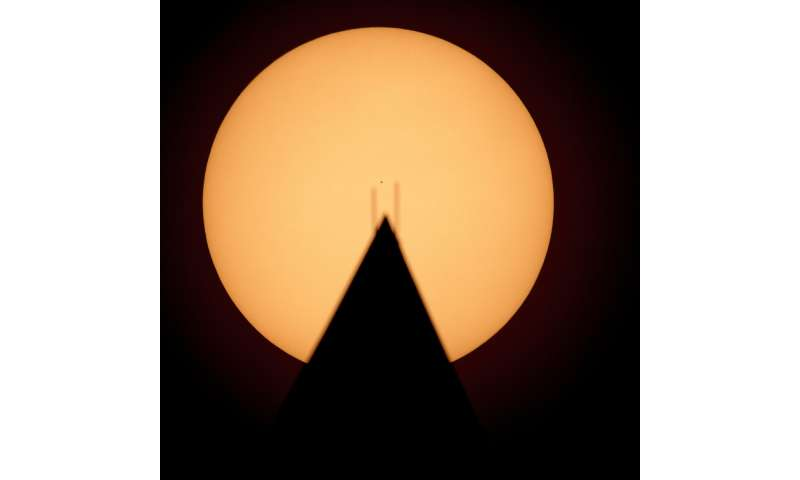 Mini Mercury skips across sun's vast glare in rare transit
