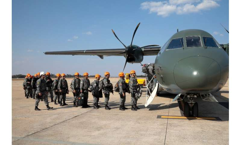 National Force military firefighters stand in line to board a plane to Rondonia northern Brazil, to help fight fires in the Amaz
