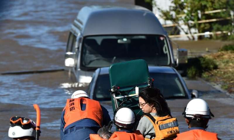 Rescue workers in Japan used boats and helicopters to reach people trapped after Typhoon Hagibis