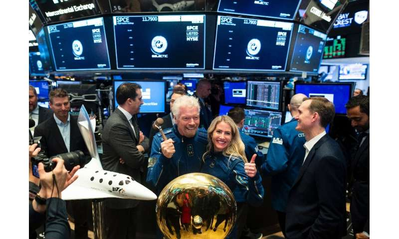 Richard Branson, founder of Virgin Galactic, poses before ringing the First Trade Bell to commemorate the company's first day of