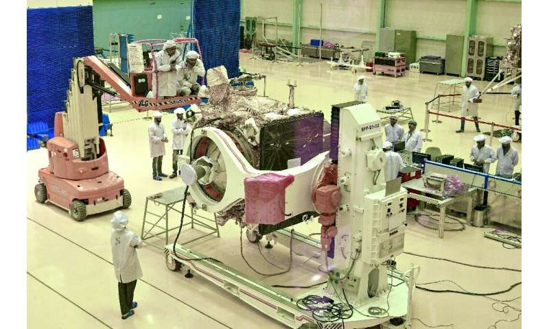 Scientists work on the orbiter vehicle of Chandrayaan-2, India's first moon lander and rover mission