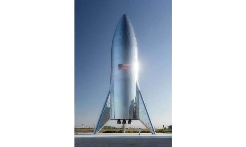 SpaceX CEO Elon Musk has unveiled the first pictures of a retro-looking, steely rocket called Starship that may one day carry pe