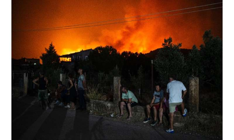 The fire that broke out on Greece's second-largest island on Tuesday caused the evacuation of several villages