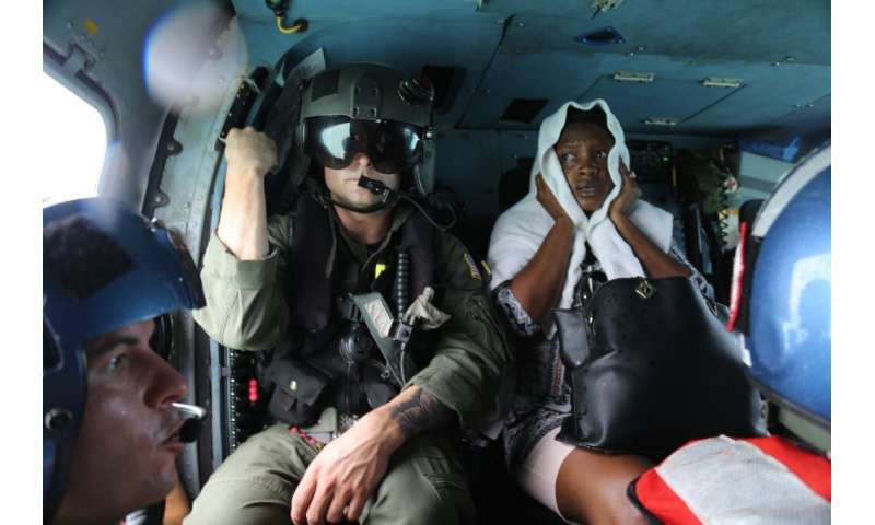 The US Coast Guard evacuates a survivor from Hurricane Dorian after rescuing her from Treasure Cay, Bahamas