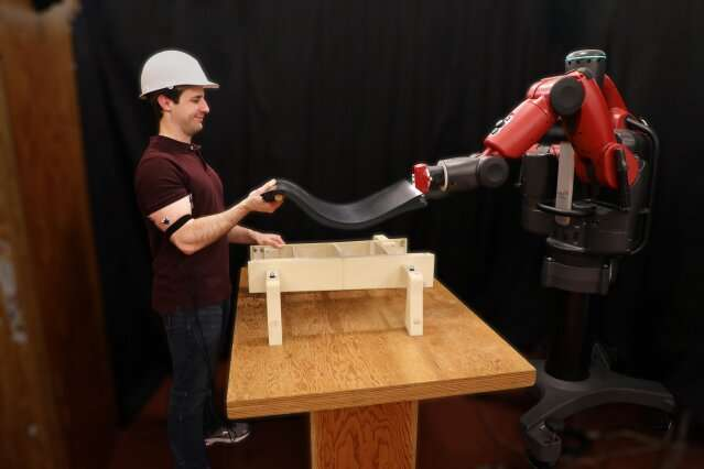 This robot helps you lift objects — by looking at your biceps