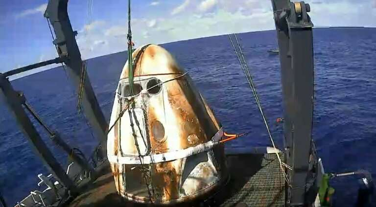 SpaceX capsule back on Earth, paving way for new manned US