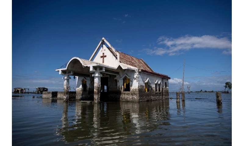 Twenty years ago the residents of Sitio Pariahan could walk to the local chapel but today reaching it requires a swim, because t