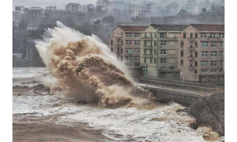 Waves hit a sea wall  in Taizhou, China. The same oceans that nourished human evolution are poised to unleash misery on a global