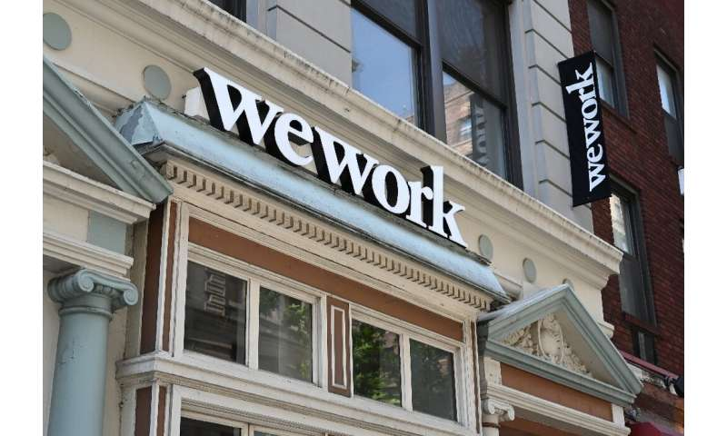 WeWork announced Monday that it will withdraw a plan to go public but will revive an initial public offering down the road