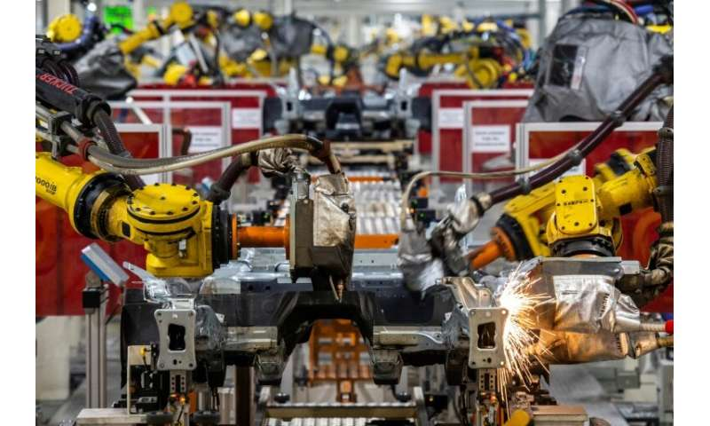 With more fully automated production lines like this one at its headquarters in Wolfsburg, Germany, Volkswagen will have less ne