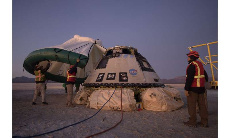 Boeing capsule returns to Earth after aborted space mission (Update)