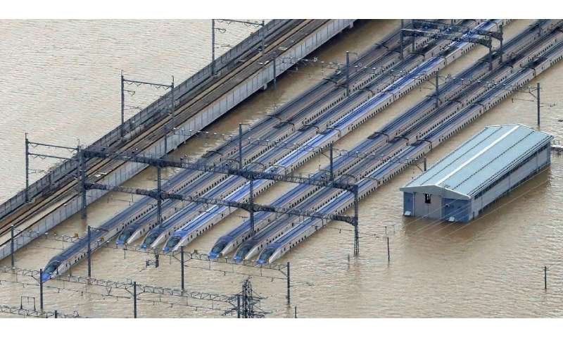 An aerial view of the flooded shinkansen bullet train depot in Nagano, where 10 trains were reportedly damaged by the typhoon wh