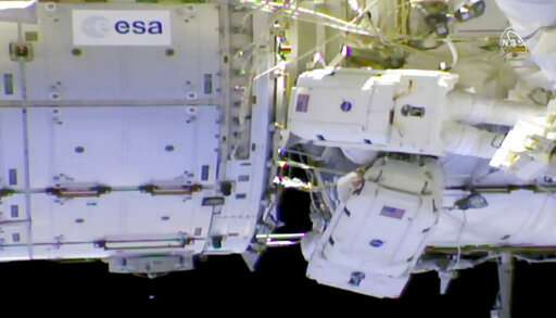 Spacewalking astronauts tackle battery, cable work