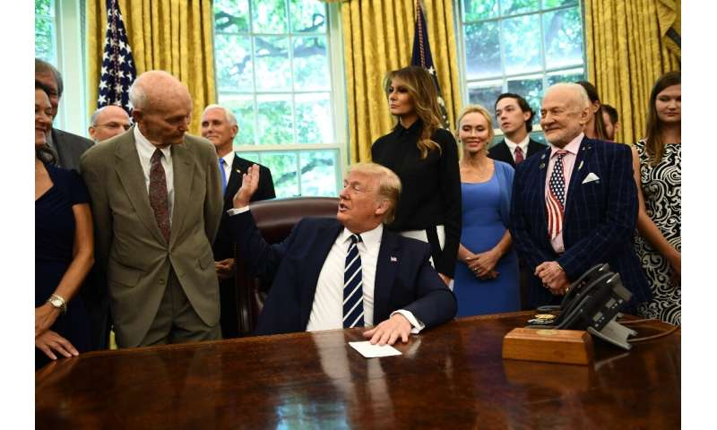 US President Donald Trump and First Lady Melania Trump host Apollo 11 crew members Michael Collins (L), Buzz Aldrin (R) and thei