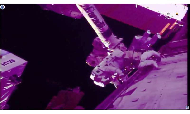 Spacewalking astronauts slice into cosmic ray detector (Update)