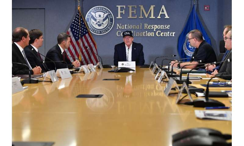 US President Donald Trump receives a briefing at the Federal Emergency Management Administration (FEMA) on Hurricane Dorian in W