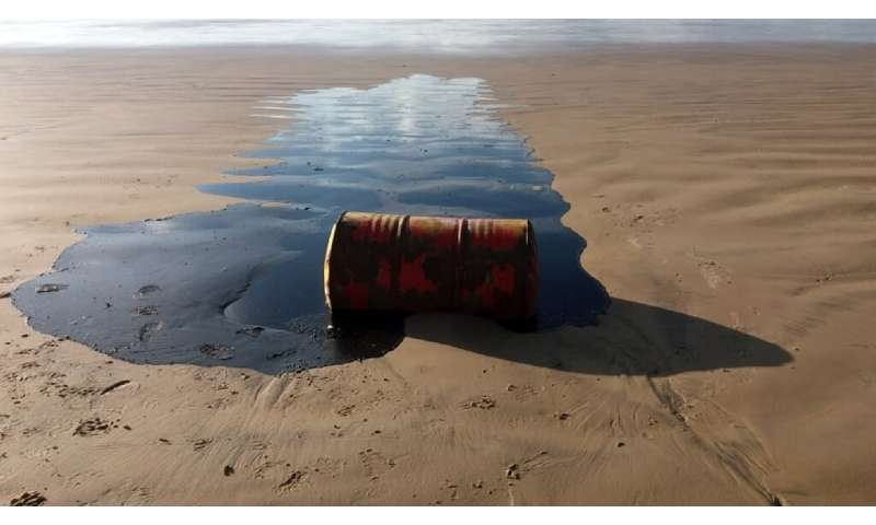 A barrel of oil spilled on a beach in Barra dos Coqueiros municipality, Sergipe state, Brazil, is pictured in September 2019 in