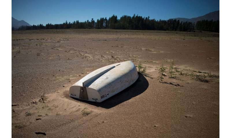 A picture taken on May 10, 2017 shows a boat lying on the sand at the Theewaterskloof Dam, which has less than 20% of it's water