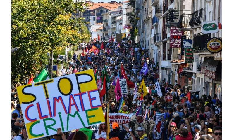 Demonstrators take part in a climate march in Hendaye, south-west France on August 24, 2019, to protest against the annual G7 Su