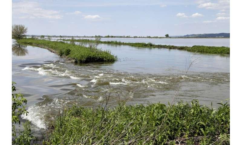 Dragging levee repairs leave riverside communities stressed