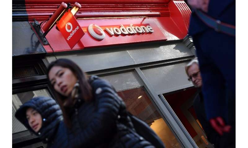 Europe's biggest mobile phone company Vodafone has slashed its shareholder divided after posting a steep annual net loss