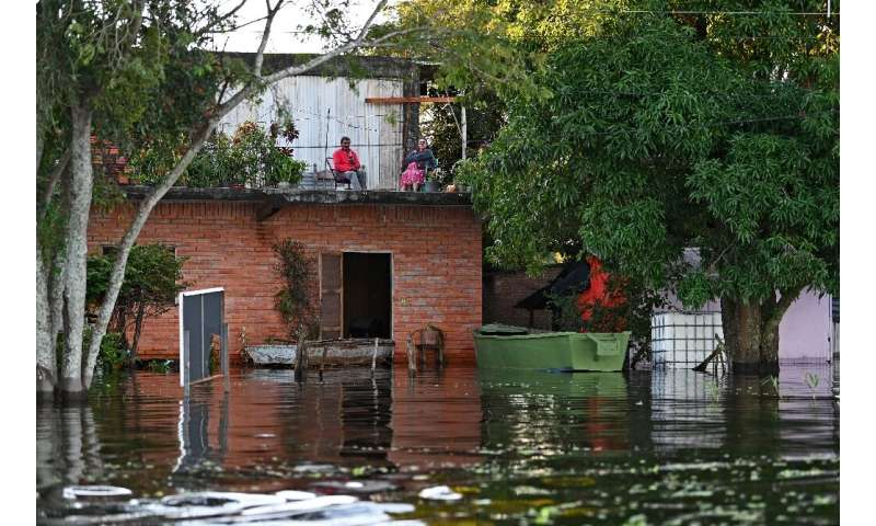 Some residents living close to the Paraguay River have had to move into the upper floors of their homes to escape the rising flo