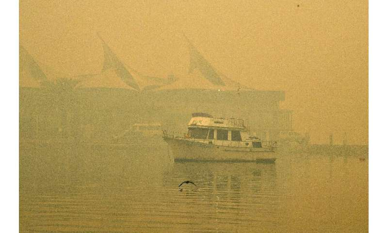 The toxic haze has made conditions on the water hazardous, with a harbour yacht race cancelled because of poor visibility