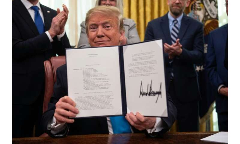 US President Donald Trump shows his signature on the Space Policy Directive-4 (SPD-4) on February 19, 2019 at the White House—he