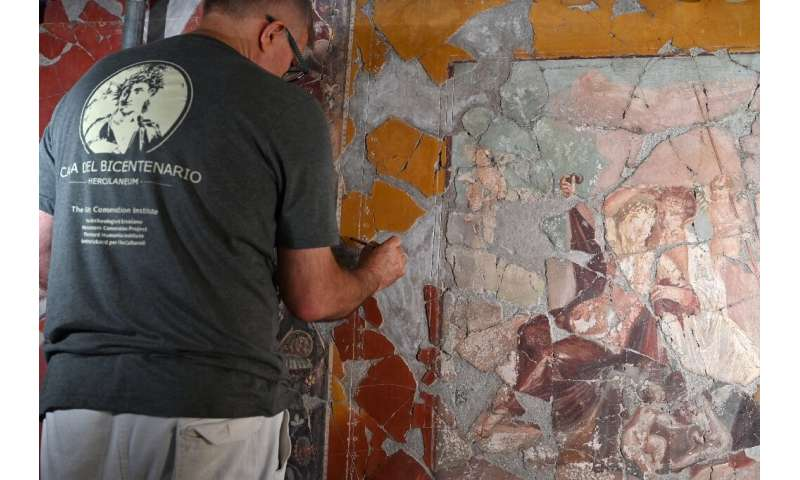 Conservationists have found a new method to remove the wax layer while still preserving the paint