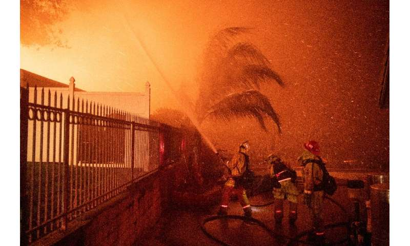 Firefighters battle wind-whipped flames engulfing multiple homes during the Hillside Fire in the North Park neighborhood of San
