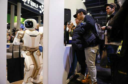 Robots walk, talk, pour beer and take over CES tech show